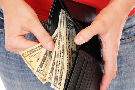 A good filled wallet in the hands photo