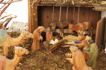 Old homemade nativity scene in front of a white background Stock Photo - 15349448