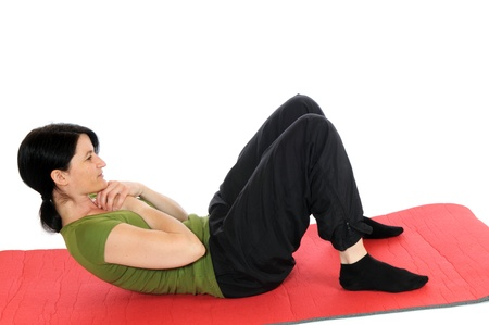 situp: Mid adult woman cares for her fitness