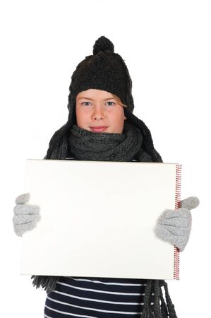 Teenager  with woolen hat and drawing block in front of a white background Stock Photo - 15452151