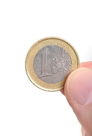 validez: Una moneda Euro delante de un fondo blanco