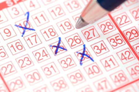 Lotto ticket with ticked numbers