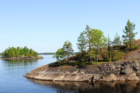 scandinavian peninsula: At the lakes around Savonlinna in Finland there are many small islands Stock Photo