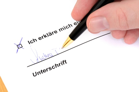 Signing a document with ballpoint pen Stock Photo - 15570548