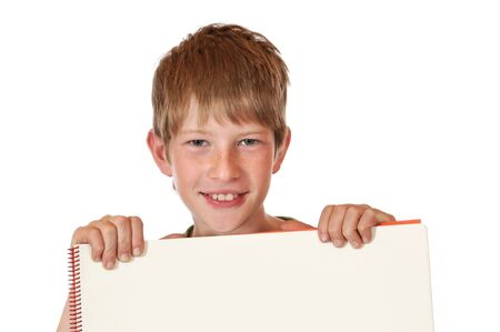 Boy with drawing block in front of a white background Stock Photo - 15570567