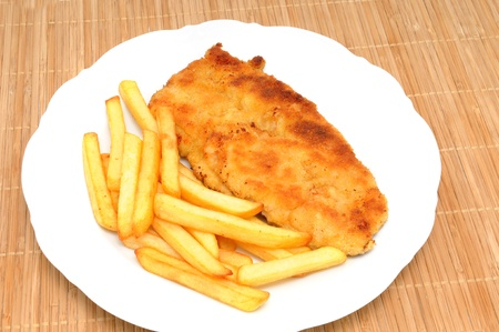 breadcrumbs: Schnitzel with french fries Stock Photo