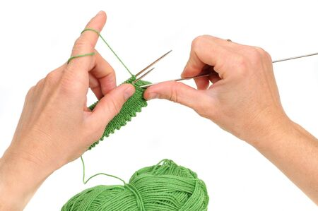 raspy: Hands of a young woman knitting