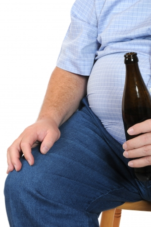 Fat man with a bottle of beer isolated on white photo
