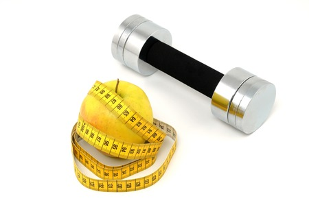 wellbeeing: tape measure and dumbbell as symbol for healthy living Stock Photo