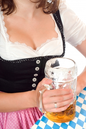Woman in dirndl with beer stein