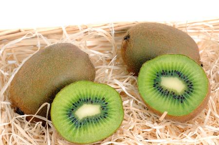 actinidia deliciosa: Fresh Kiwi on a straw bed