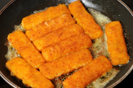 Fish fingers in a frying pan photo