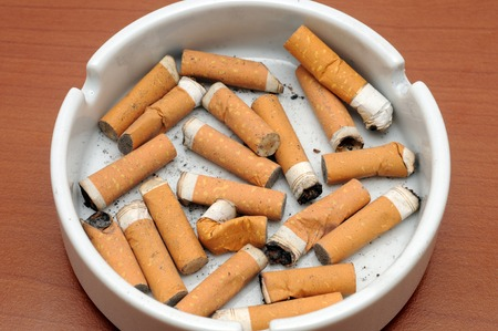 Ashtray with cigarette photo