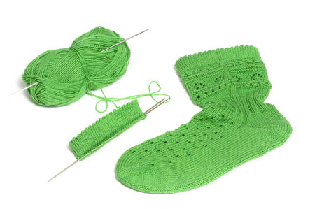 raspy: Green knitting wool on white background