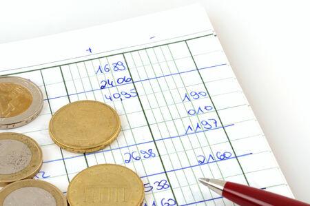 ballpen: Handwritten cash book with coins and ballpen writer
