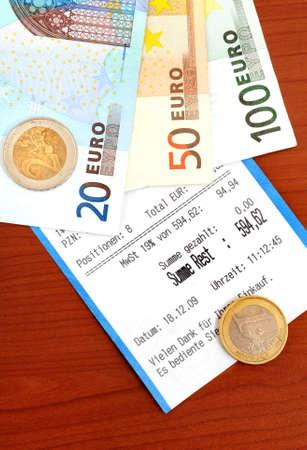 cash receipt: Cash receipt on a brown table