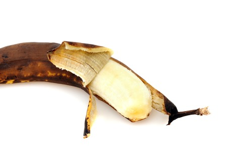 Overripe banana in front of a white background photo