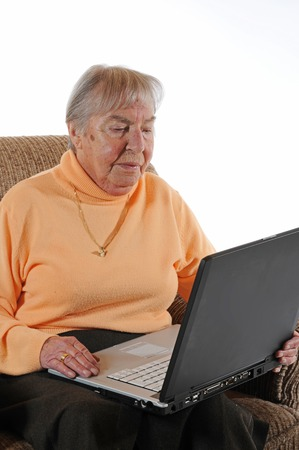 Senior vrouw met een laptop Stockfoto