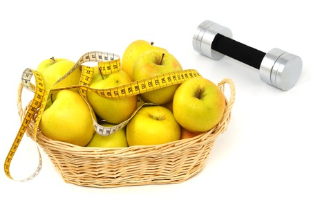 wellbeeing: Apple and dumbbell as symbol for healthy living