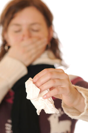 Young woman in thick sweater is suffering a cold photo