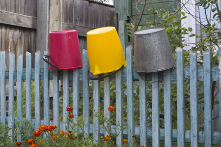 paling: Village paling with three suspended buckets