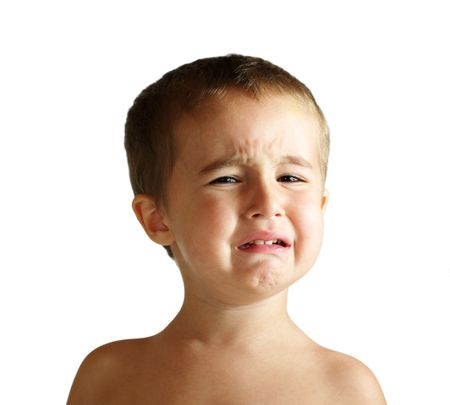 Small boy pretends to cry, isolated on white background
