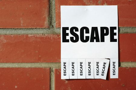 Tear-off escape ad on the red brick wall Stock Photo - 5952701