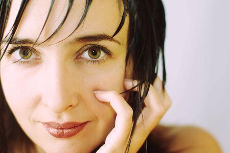 haircuts: Beautiful woman face close-up with nails and sharp haircuts Stock Photo
