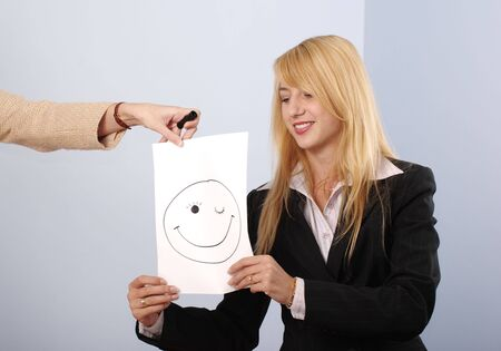 Blonde women in the office recieve the good mood message photo