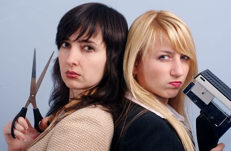Blonde and brunette women task forece team in the office photo