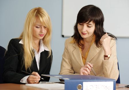 Blonde and brunette women on the meeting in the office Stock Photo - 5999874