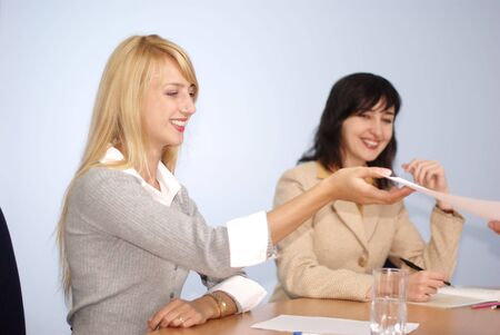 Blonde and brunette women on the meeting in the office photo