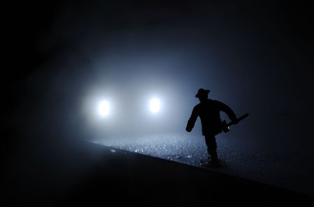 burns night: Toy firefighter run onto the car lights in the mist  Stock Photo