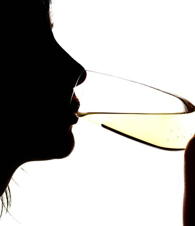 Silhouette of the girl drinking sparkling wine, isolated on white