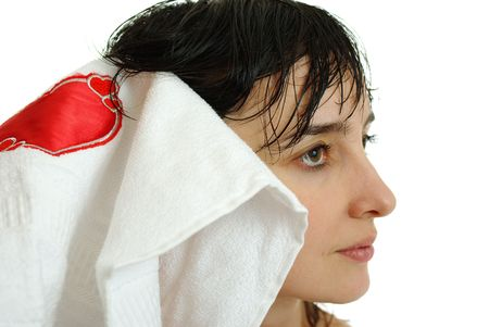 Beautiful brunette woman with wet hair in white towel with red heart, isolated on white background photo