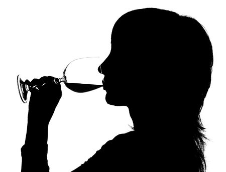 Silhouette of the woman drinking red wine on white background Stock Photo