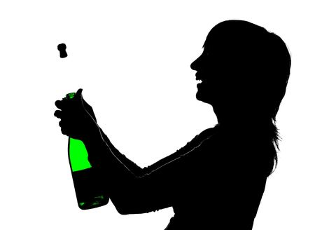 Silhouette of the woman with green bottle in hands opening champagne so that cork is shoot out, isolated on white photo