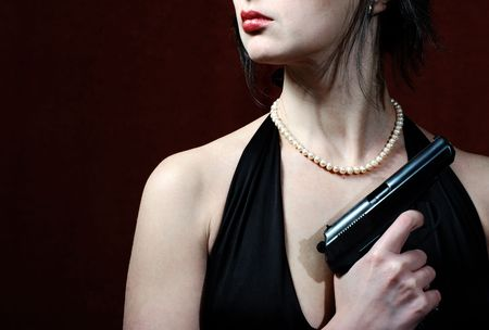 murdering: Beautiful woman in evening dress with gun, just lips and torso  Stock Photo