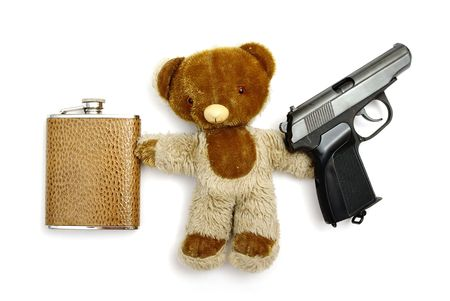 Teddy bear with gun and flask isolated on white photo
