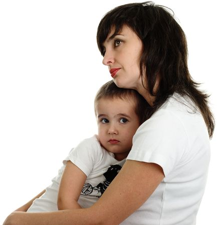 Thoughtful mother holds her son in her arms, isolated on white Stock Photo