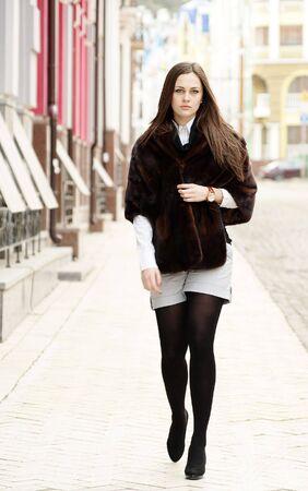 stole: Beautiful girl in stole walking down the street