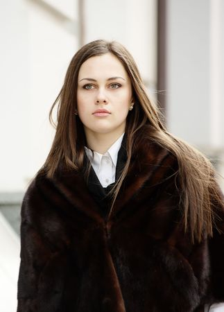 log hair: Beautiful girl in fur stole in the downtown Stock Photo