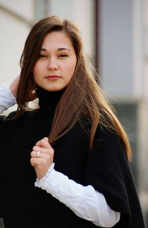 Portrait of young woman with long hair outdoors photo
