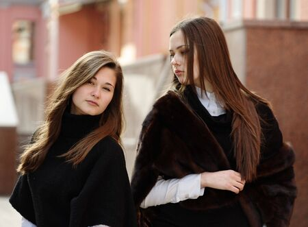 Two beautiful girls outdoors in the downtown photo