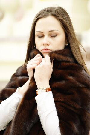 stole: Girl  enjoyes her fur stole with closed eyes  Stock Photo