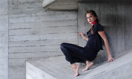 Young woman climbs caught in sharp edges of concrete trap photo