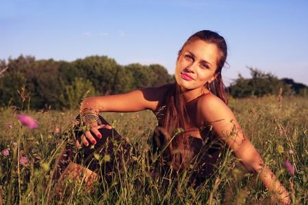 Cross processing portrait of girl enjoying summer evening sitting on meadow Stock Photo - 7419185