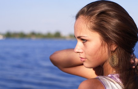Beautiful girl profile at the river in the evening sun Stock Photo - 7447648