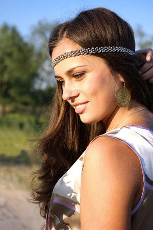 60s hippie: Hippie brunette girl outdoors summer portrait Stock Photo