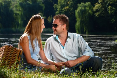 Loving couple confess in love on the river shore photo